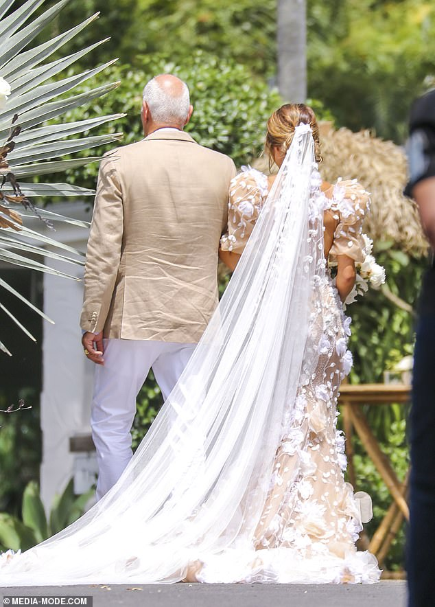 Gorgeous! The brunette beauty wore a flowing white veil on the day