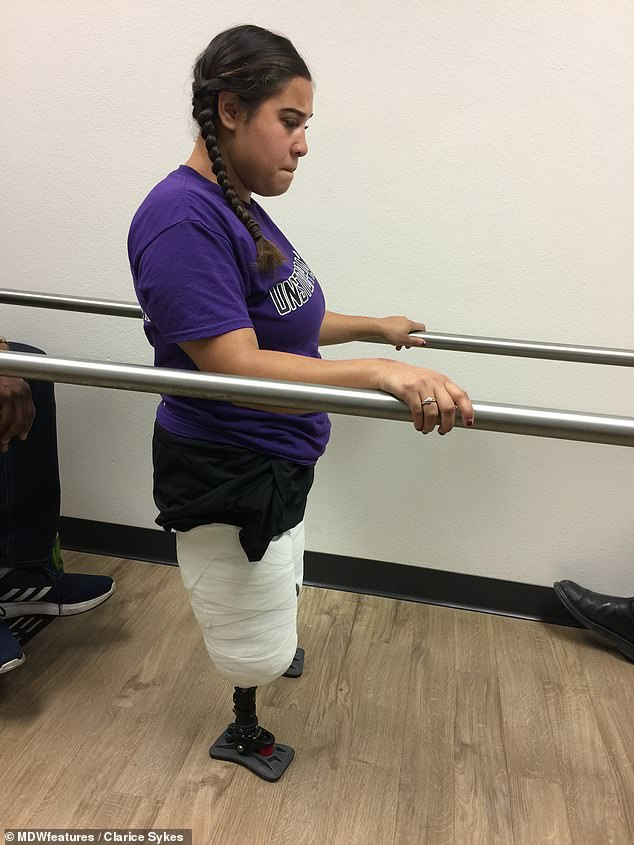 Road back: Ms Sykes had to learn to walk again on her amputated legs before she could be fitted with her new prosthetic legs