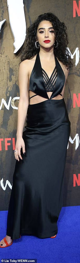 Va va voom! Songstress Kara Marni looked undeniably glamorous in a slinky black dress which sensational cut-out detailing