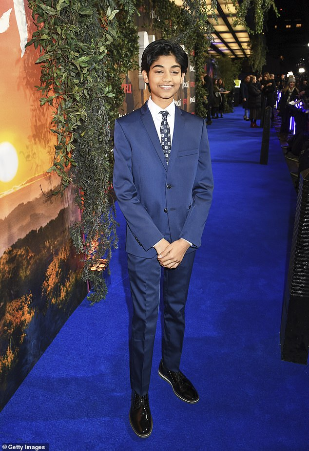 Cute: Rohan Chand looked adorable in his little navy suit, which he teamed with a crisp white shirt and tie