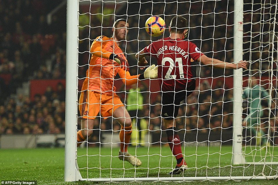 Herrera (right) fails to clear the ball off the line after De Gea (left) had allowed it to slip through his hands
