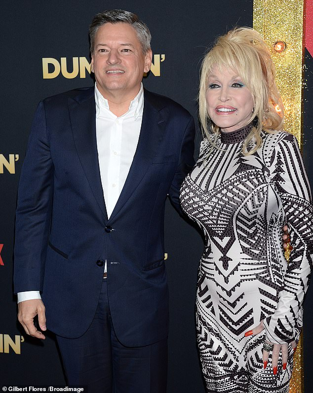 The boss: Dolly and Netflix's Chief Content Officer Ted Sarandos posed together