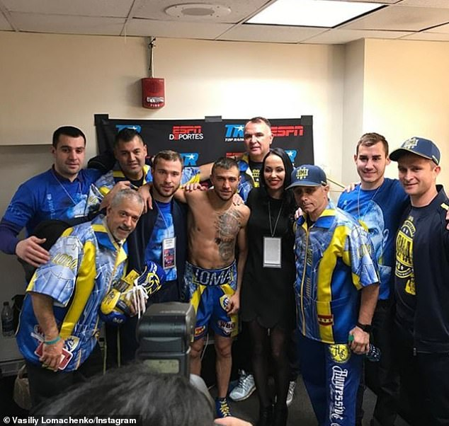 Team Lomachenko includes cornerman Russ Abner (second left), strength and conditioning coach Cecilio Flores (3rd left), Lomachenko (center), Egis Klimas (5th left), Anatoly Lomachenko (3rd right) and team psychologist Andriy Kolosov (right)