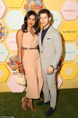Loved up: The 36-year-old actress and 26-year-old singer at a Bumble launch party in New Delhi on Wednesday