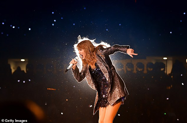 Swift is seen performing onstage during the 2018 reputation Stadium Tour at Soldier Field on June 1 in Chicago, Illinois
