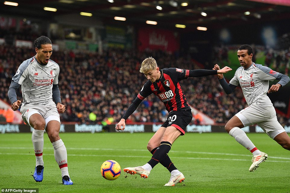 Welsh international David Brooks gets a shot away for Bournemouth but sees his effort saved by Liverpool goalkeeper Alisson