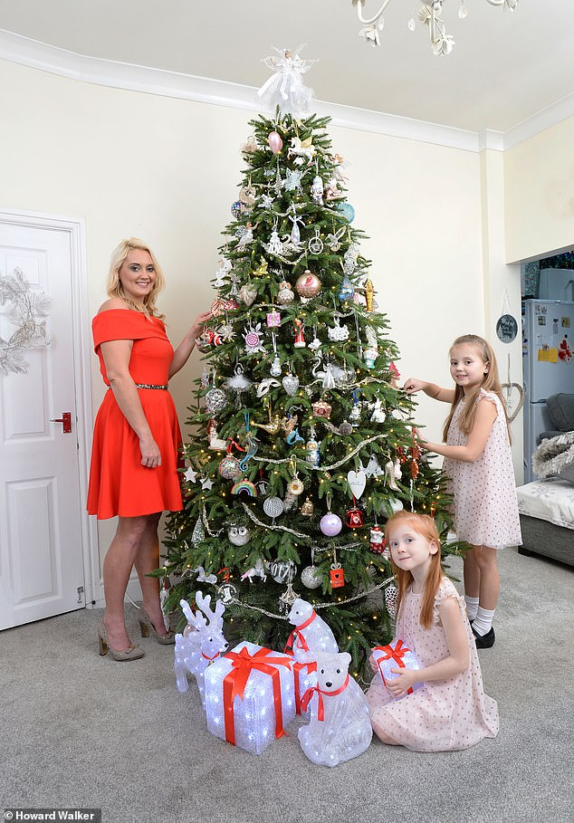 This week, Laura Howell (pictured with her daughters Scarlett 8 and Sienna 5) transforms the art of tree styling into something far more elaborate - and much more expensive