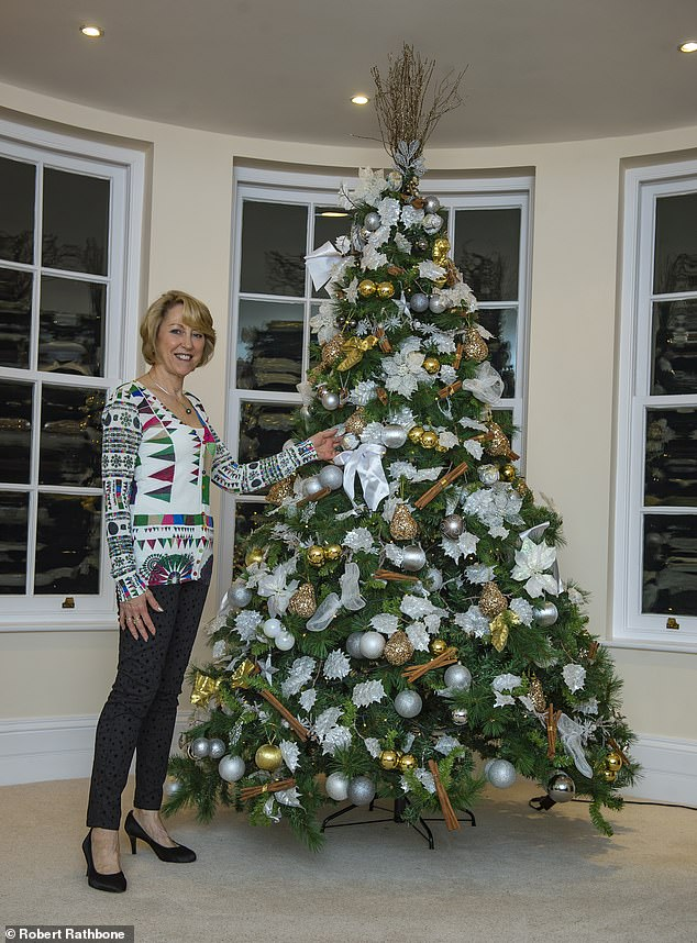 In her living room is a 9-foot tree adorned with white and gold balls. The retired couple, which has two children and three grandchildren, now has three stunning trees near Market Harborough in Leicestershire