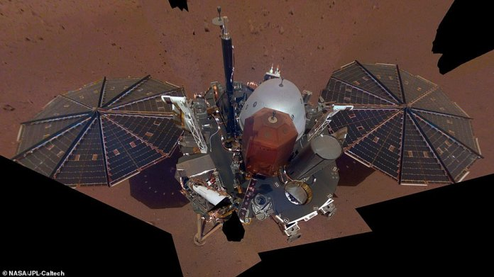 Even the robots of Mars behave like tourists every now and then. NASA's new InSight lander has taken its first selfie from the red planet, giving the mission team (and the rest of the world) a good look at its solar panels and its deck now that it's set