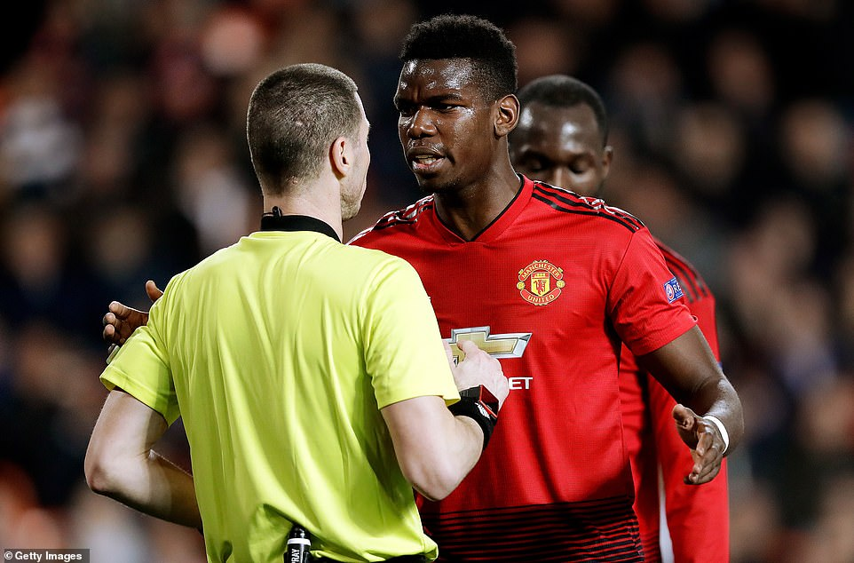 Paul Pogba confronts Bulgarian refereeGeorgi Kabakov after a decision fails to go United's way on Wednesday night in Spain