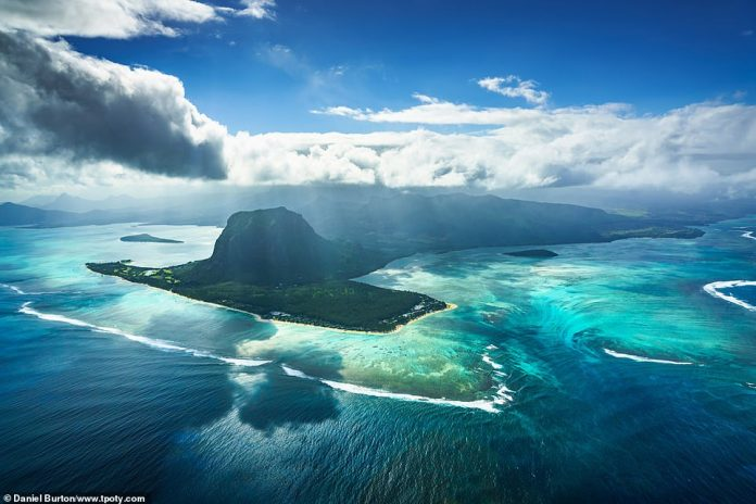 British photographer Daniel Burton was named runner-up in the travel portfolio of the year category. One of his stunning pictures shows the island of Le Morne in Mauritius and its unique natural phenomenon, an 'underwater' waterfall. The illusion can be see on the right, with water seemingly pouring down towards the seabed