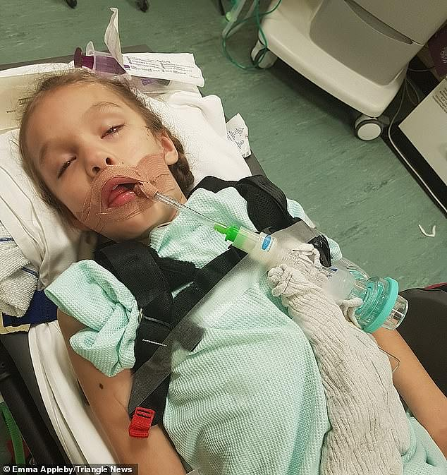 Doctors were forced to put Teagan (pictured in hospital) in a medically-induced coma after she had five seizures over eight days last summer and became unable to even feed herself