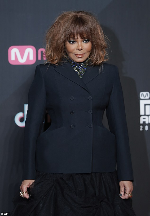 Sued: Janet Jackson (pictured December 14 in Hong Kong) and her brother Randy Jackson are being sued by a former tour