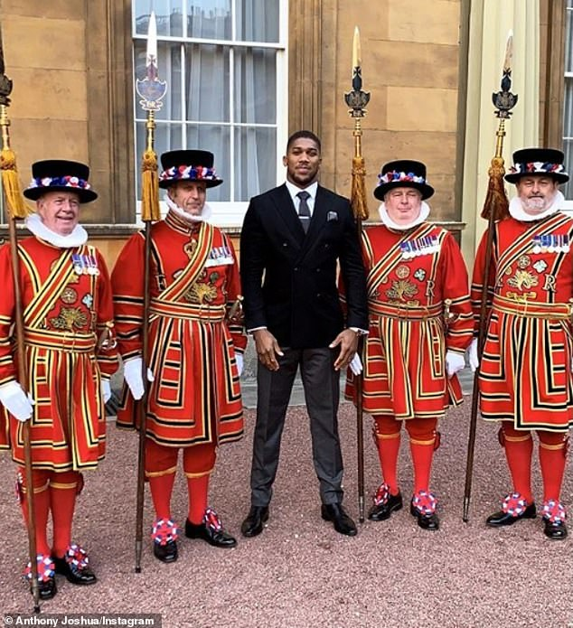 Joshua poses with the Palace's Beefeaters after the ceremony had come to its conclusion