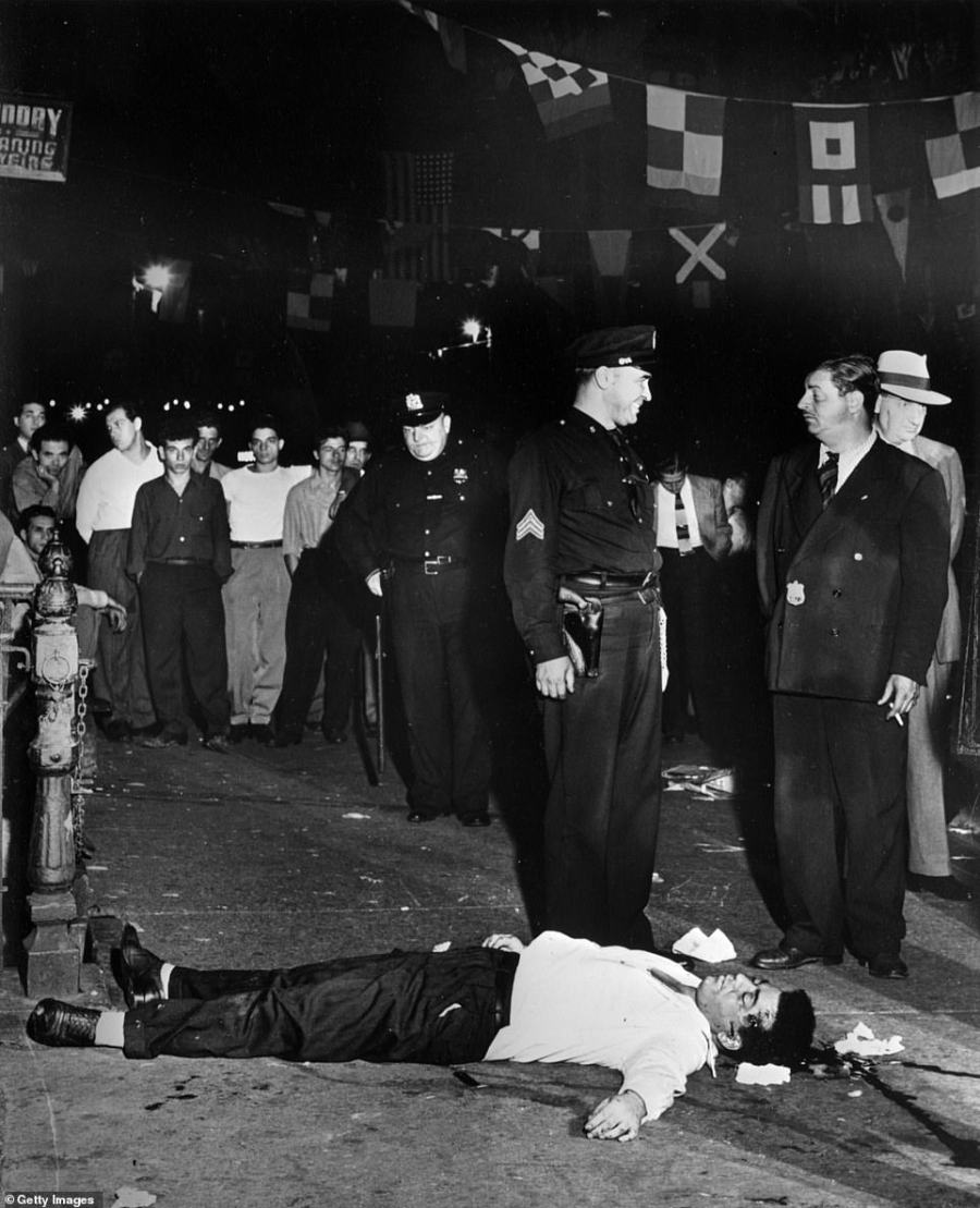San Gennaro slaughter: This photo shows the scene of the murder of two men at the feast of San Gennaro in 1939. Joseph 'Little Joe' La Cava and Rocco 'Chickee' Fagio were both found dead on Mulberry Street