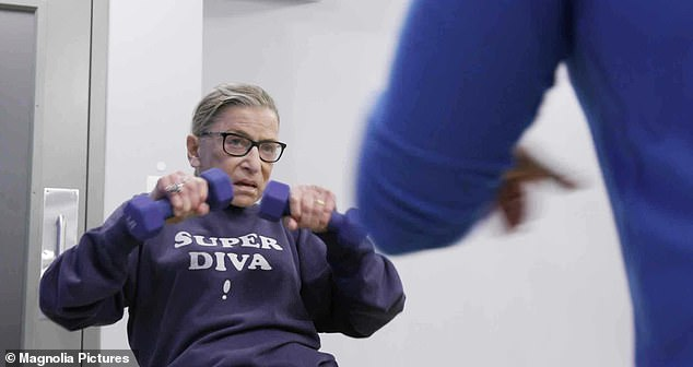 Ruth Bader Ginsburg, pictured at the gym during the 2018 documentary, 'RBG.' Ginsburg had become a pop culture sensation in her 80s, and an interest in her workout took hold. So much so that her trainer of many years, Bryant Johnson, wrote the book 'The RBG Workout.' Above, The octogenarian would do exercises such as a wall squat with a yoga ball