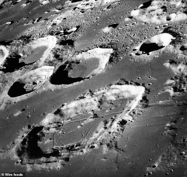 This Dec. 29, 1968 photo made available by NASA shows the large moon crater Goclenius, foreground, approximately 40 statute miles in diameter, and three clustered craters Magelhaens, Magelhaens A, and Colombo A, during the Apollo 8 mission