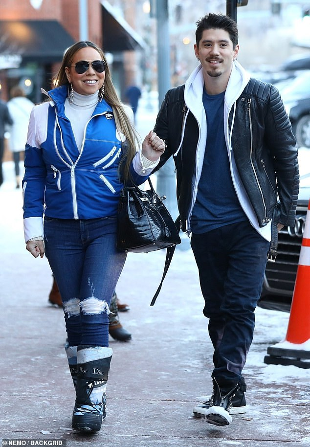 In sync: Mariah Carey seemed happier than ever when she was dating Saturday with her boyfriend Bryan Tanaka in Aspen