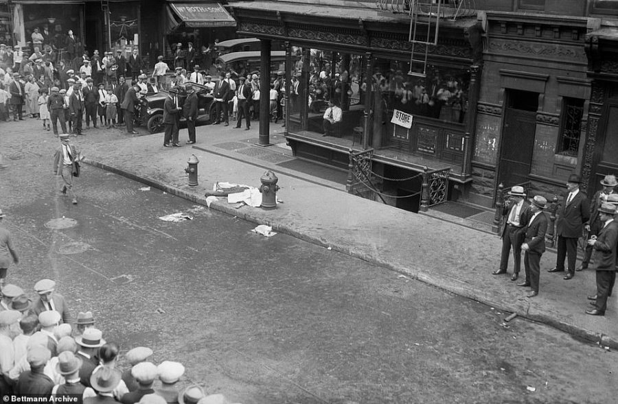 Mott Street murder: Crowds are pictured around the body of a man dumped on New York sidewalk
