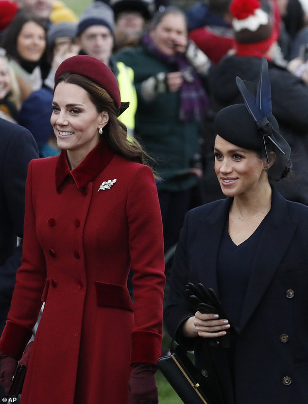 Sisters united: Kate and Meghan both appeared happy and relaxed as they walked to the church yesterday. Kate wore a bright red coat, alongside Meghan, who chose a black outfit