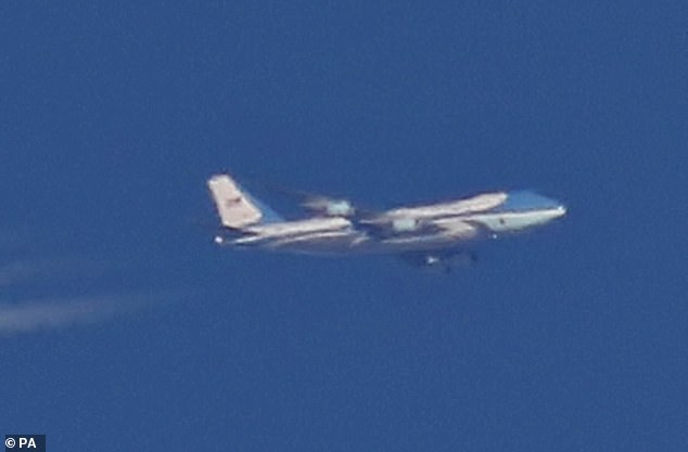 Alan Meloy, from Sheffield, was peering up at the sky, from the front step of his home when he managed to photograph Air Force One (pictured)