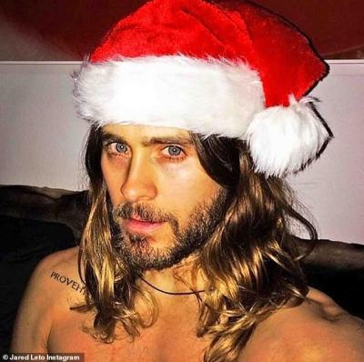 Santa hat: Jared Leto posted this shirtless photo of himself on Christmas Day in a Santa Claus hat and followed up with another on Thursday after turning age 47