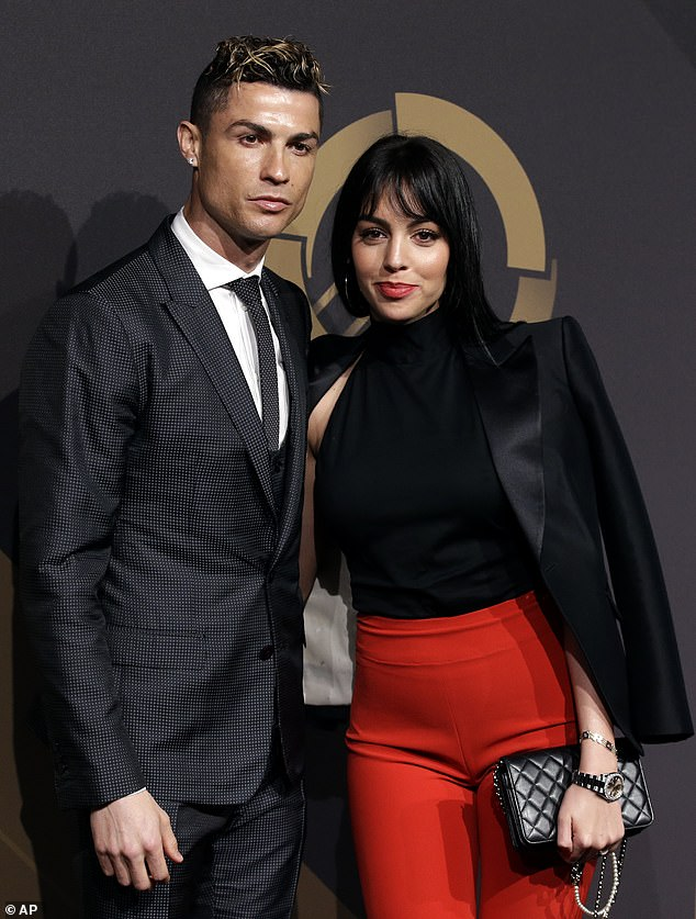 Loved up:The couple are believed to have met while Georgina was working at the Gucci store in Madrid, Spain, and went public with their romance in late 2016 (pictured in March)