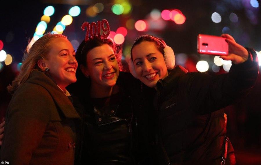 Rikki Maroney, Anni Crowley and Mallori Logan from Australia on Princess Street  during the Hogmanay New Year celebrations in Edinburgh