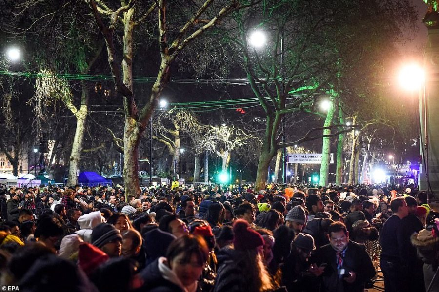 Revellers wait for the fireworks over the London Eye marking the coming of the New Year in central London. More than 100,000 spectators were expected to watch Europe's largest display including eight tones of fireworks connected to 5,000 firing circuits