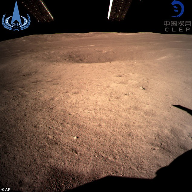 A never-before-seen 'close range' image taken by the Chinese spacecraft Chang'e 4 of the surface of the far side of the moon
