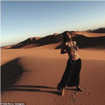 'Take care of your body, it's the only place you have to live!'Halle Berry, 52, posted a stunning topless pic from the Sahara Desert on Thursday