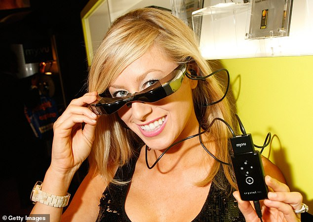 Miranda Meagher working at the 2009 CES, showing off a pair of 'TV glasses'