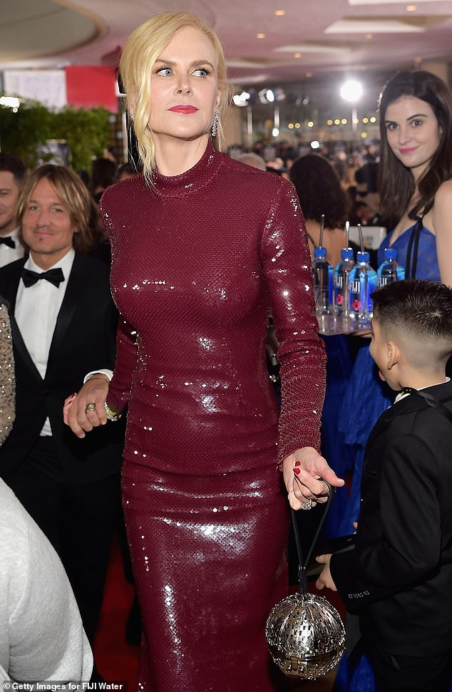 'Queen': The model even managed to sneak into the background of a picture of Nicole Kidman - and looked more prepared for the camera than the actress did