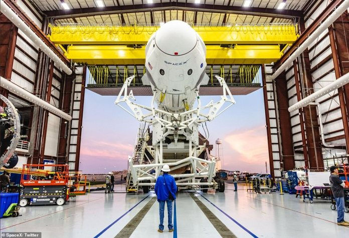 The rocket rolling out of the SpaceX hanger to historic Launch Complex 39A in Florida