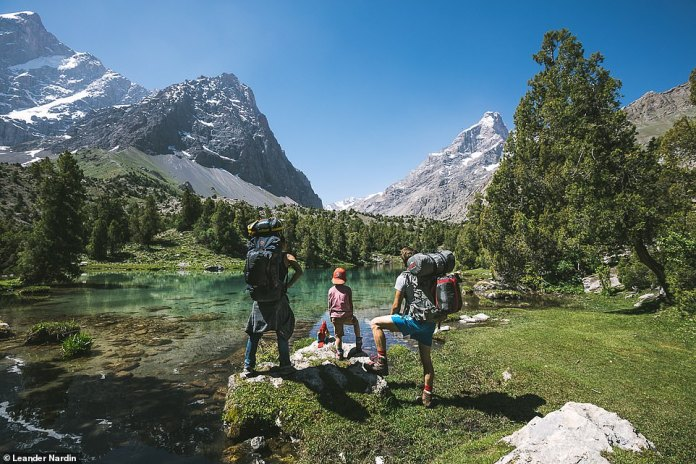 The family has always loved to travel and immerse themselves in the cultures of foreign countries. The trio is depicted looking at the beautiful mountains of Tajikistan