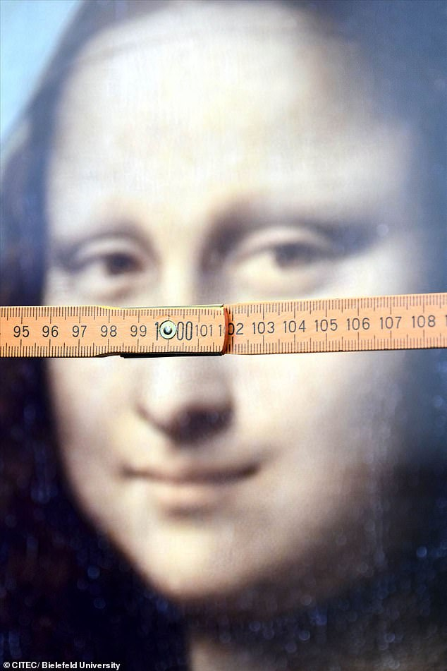 Researchers used folding rulers for measurements (pictured) and participants indicated the number they thought her gaze was directed at. This mysterious phenomenon has now been confirmed as a legitimate illusion but scientists claim the Mona Lisa does not exhibit it