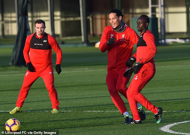 Van Dijk smiles as he chases the ball in one exercise with the Dutchman the only fit centre back