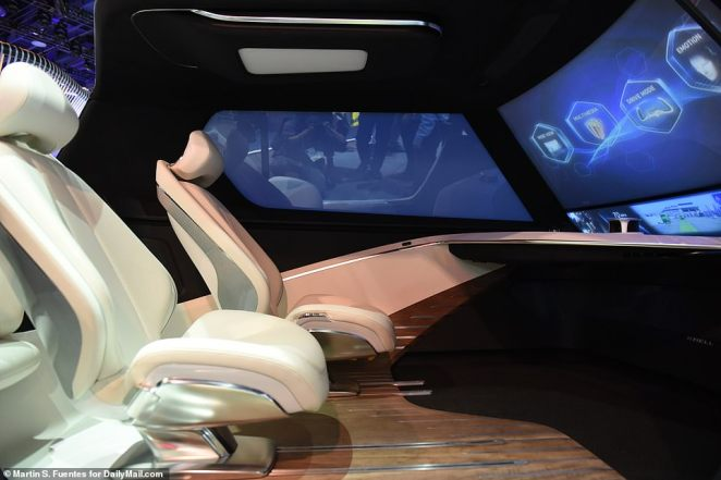 The car features level five autonomy, as well as a gesture-based system where users point their fingers or wave their hands to move through different modes displayed on the windshield. There's a spacious area in the front with massive displays