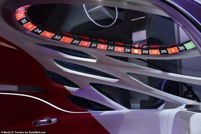 Above riders' heads is a circular LED display, which Mercedes calls the 'halo display,' that can show things like points of interest and how far away they are from their destination