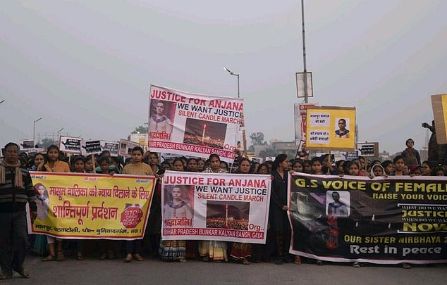 Hundreds of protesters march through Gaya as they hold placards saying 'Justice For Anjana'