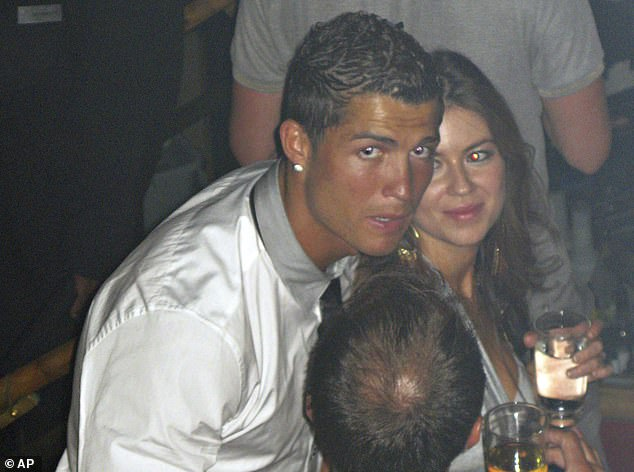The night before: Cristiano Ronaldo pictured with accuser Kathryn Mayorga in Rain Nightclub in Las Vegas on June 12,  2009