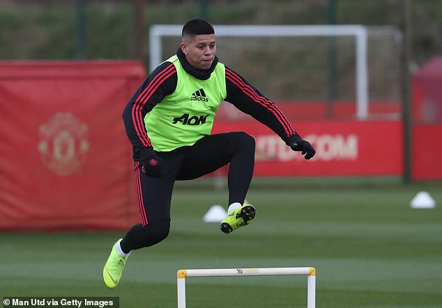 Defender Marcos Rojo has returned to Argentina as he continues to recover from a leg injury