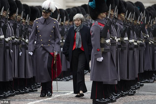 Gibbsays Mrs May was 'frustrated' by their actions; she had not approved them – and they had not even bothered to ask her permission. Pictured with a senior British Army officer