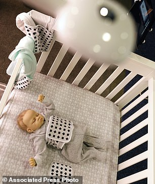 A Nanit Plus baby breathing monitor is mounted on a crib at the Nanit booth at CES International on Wednesday, January 9, 2019, in Las Vegas. (AP Photo / John Locher)