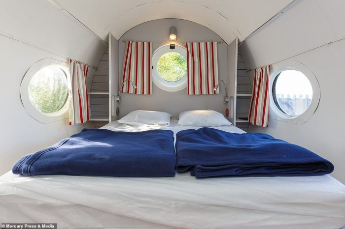 The plane hotel can sleep up to four people and has a small bedroom with a double bed, pictured, where two guests can sleep
