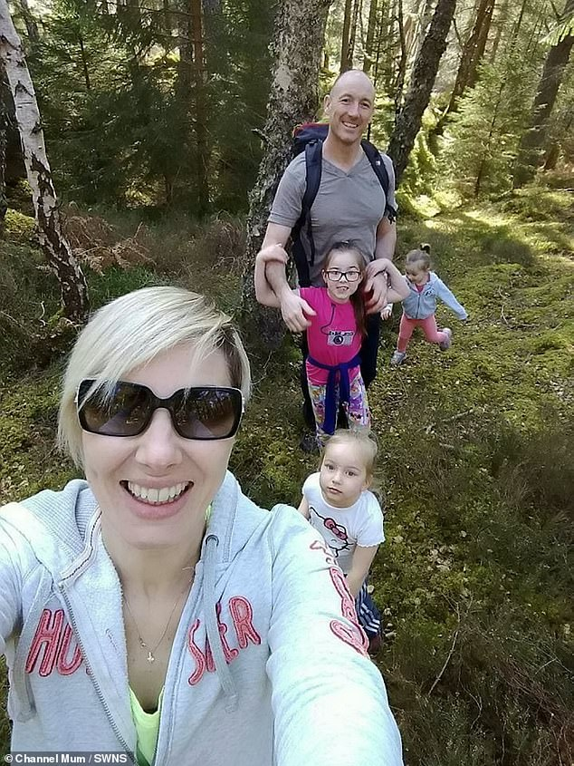 """Ms. Bremner shared the photo with the ChannelMum.com parent site in an attempt to dispel the myth that the C sections are """"easy"""" (pictured with her family)"""