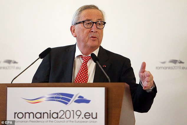 The EU is working on 'clarifications' to the Brexit deal to avoid the 'catastrophe' of Britain crashing out without an agreement, Jean-Claude Juncker (pictured today in Romania) said