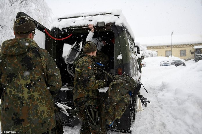 Soldiers used tracked support vehicles to battle through drifts in the town of Berchtesgaden in the Bavarian Alps close to the Austrian border