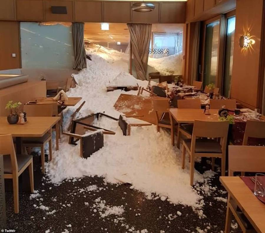 Swiss emergency crews have launched a search operation after an avalanche crashed through a hotel restaurant (pictured) while guests were eating