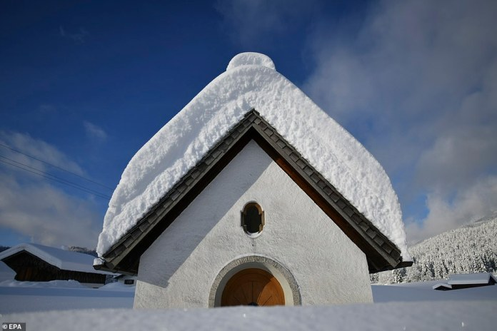 Snow covers a chapel in Gerold, Germany, after the country was coated in a thick layer of snow. Weather forecasts warn that a snowstorm could cause roadblocks and increased avalanche danger in many parts of the affected region